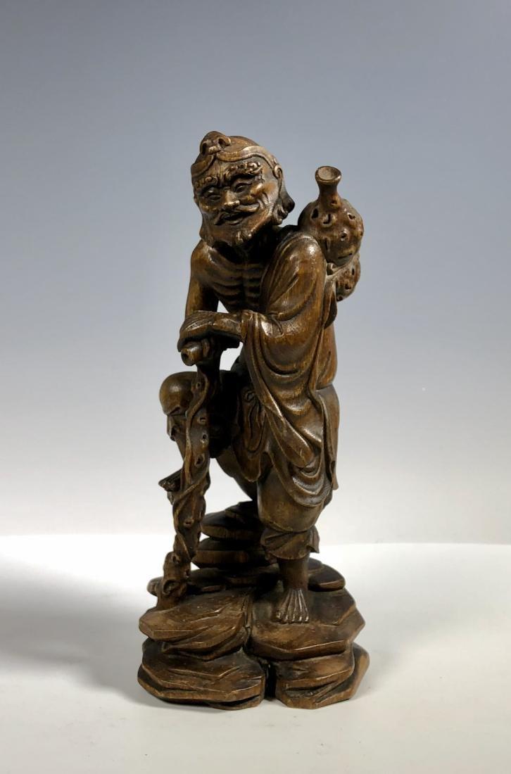 Agar Wood Carving of Scholar