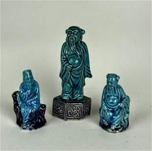 SET OF THREE BLUE GLAZED PORCELAIN FIGURES
