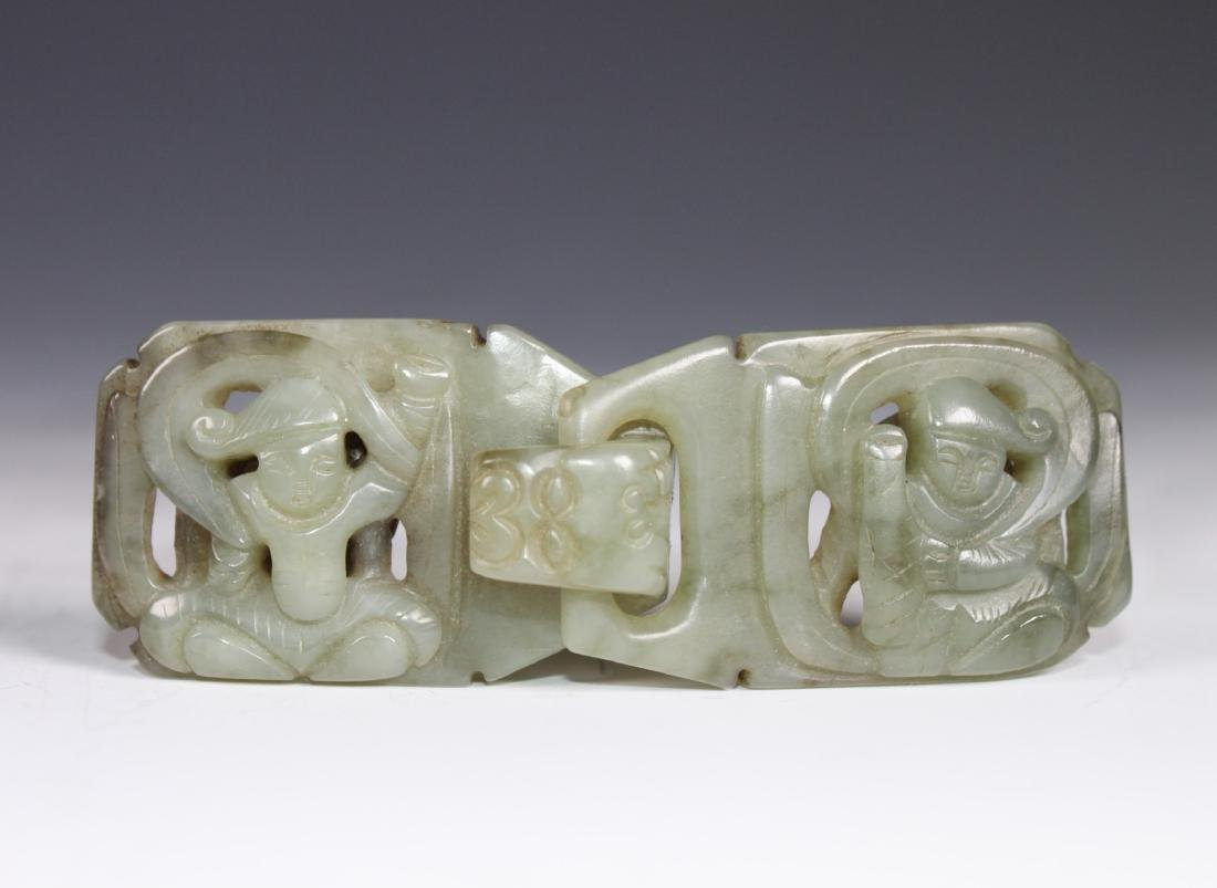 A Carved Celadon Jade Belt Buckle