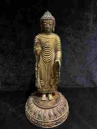 GILT BRONZE FIGURE OF A STANDING BUDDHA