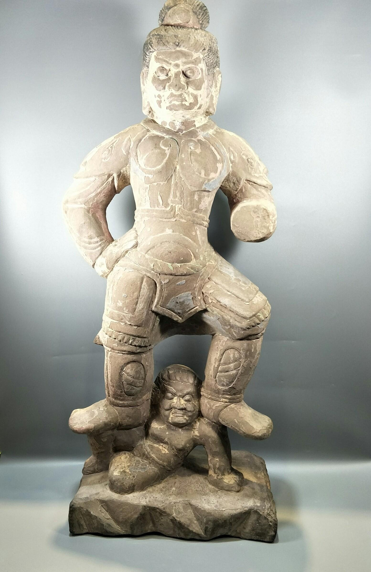 CARVED STONE FIGURE