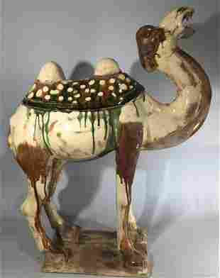 A SANCAIGLAZED POTTERY FIGURE OF A CAMEL
