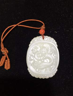 White jade dragon pendent