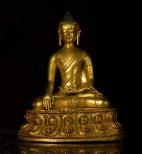 A Gilt Bronze Figure with Silver Inlaid Eyes
