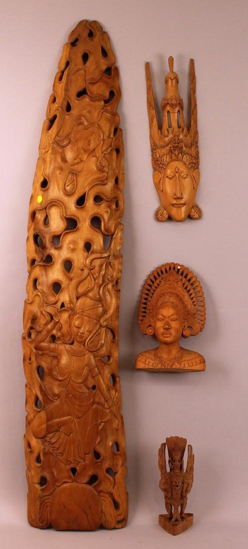Group of Four Balinese Wood Carvings
