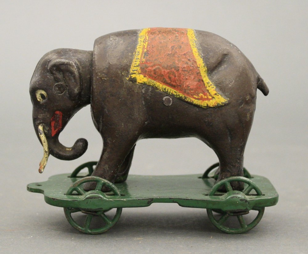 Elephant with Tusks on Wheels Mechanical Bank