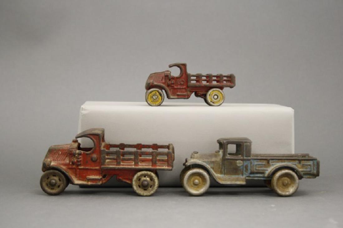 Lot: Three Flatbed Trucks