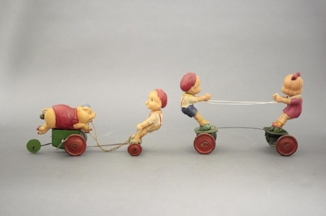 Lot: Boy Chasing Pig, Boy & Girl Tug of War