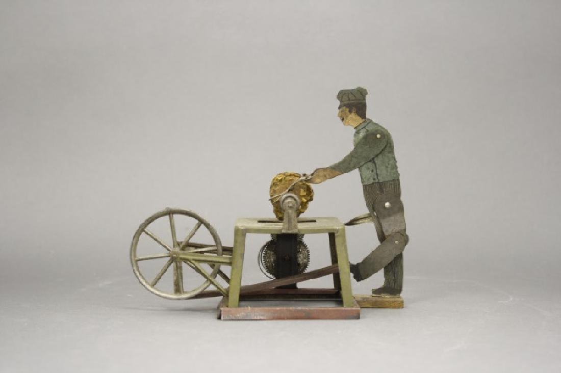 Man at Scissor Sharpener Windup Toy