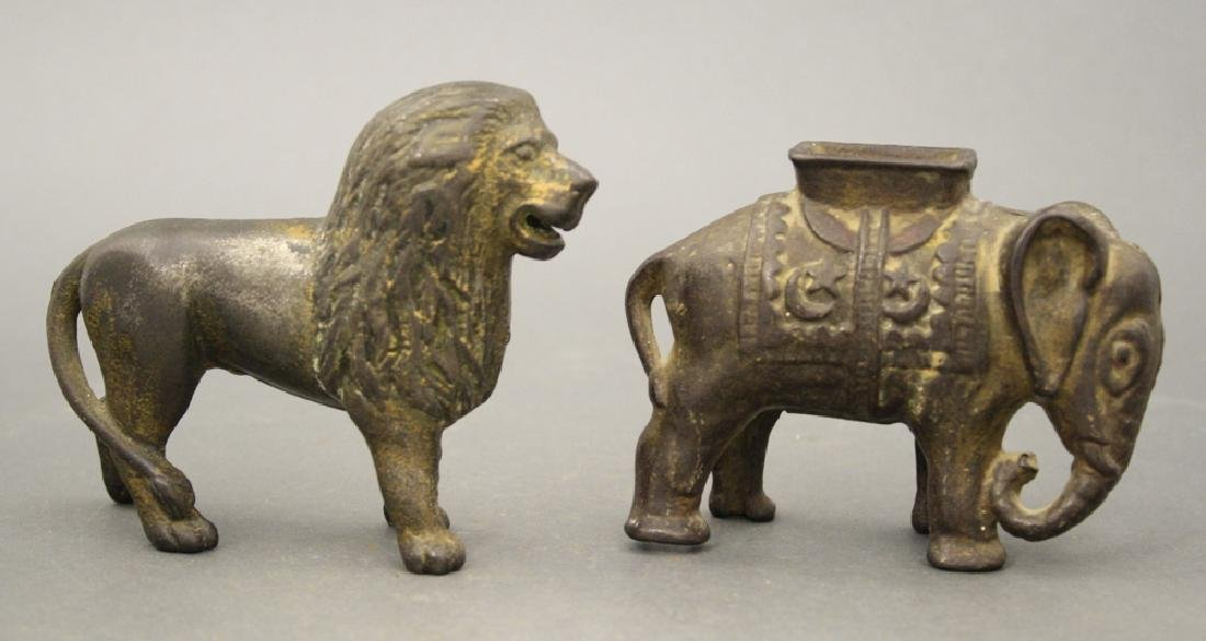 Lot: Lion Tail Right and Elephant with Howdah Banks