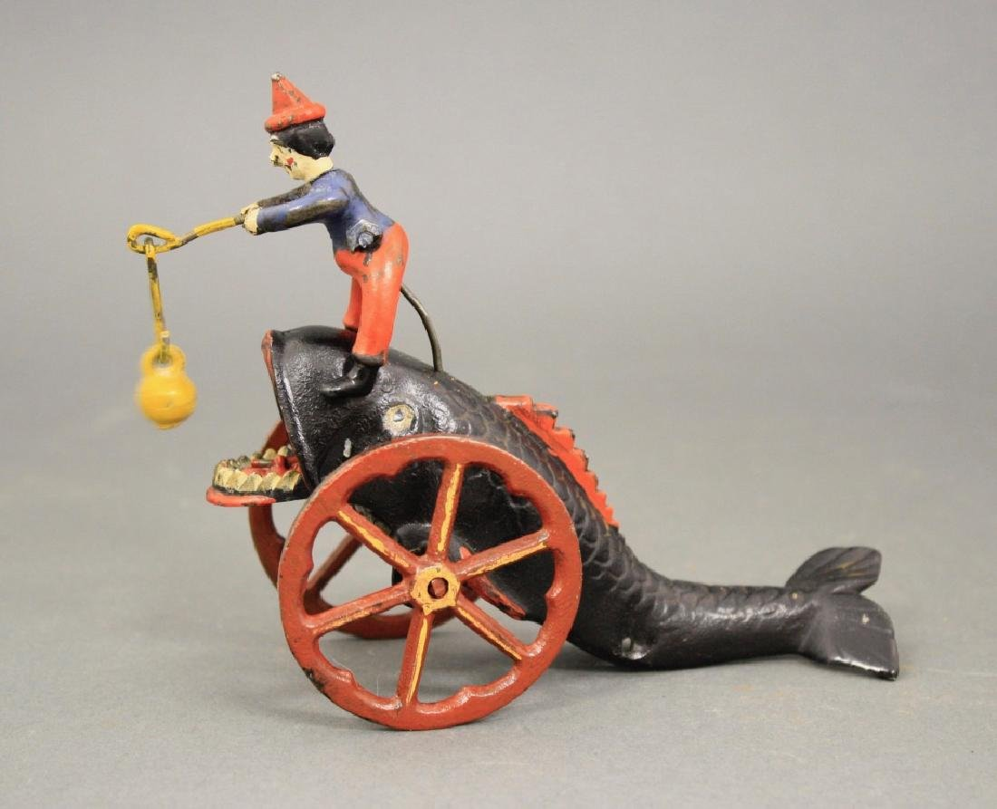 Clown Riding a Whale's Back Bell Toy