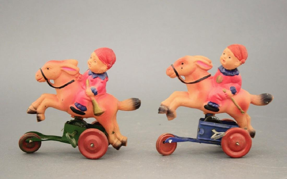Lot: Two Young Clowns on Donkey