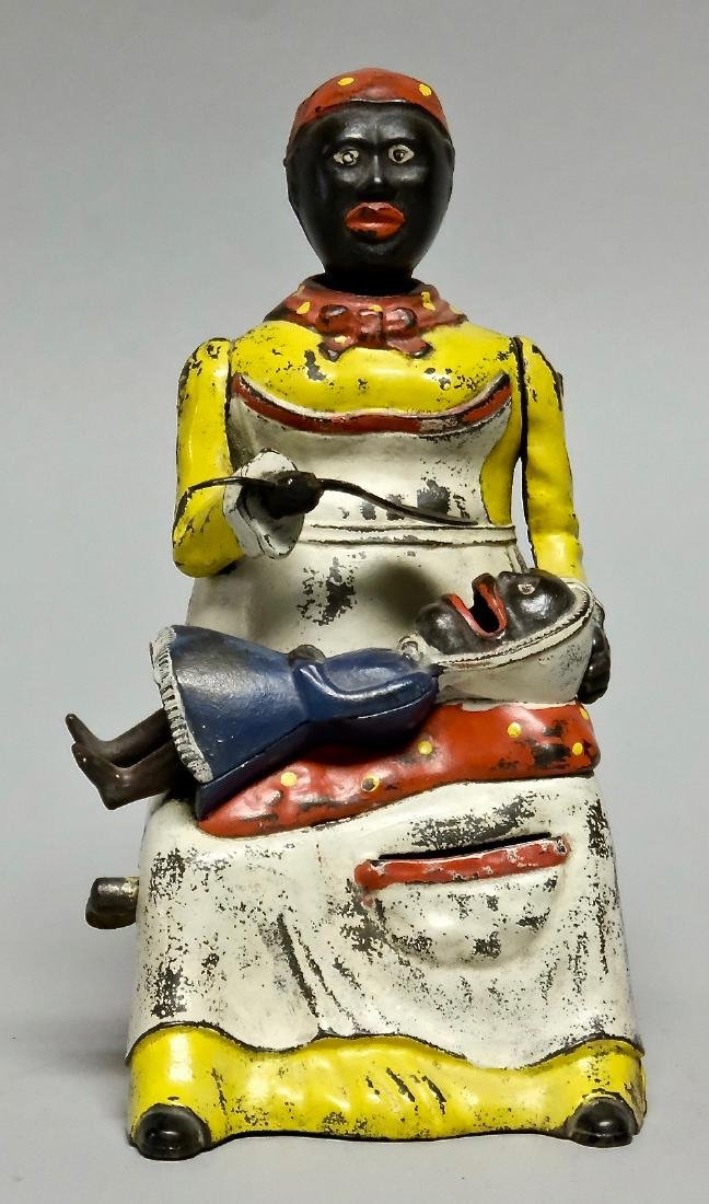 Cast Iron Yellow Mammy and Child Mechanical Bank