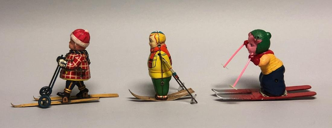 Three Windup Tin and Celluloid Skier Toys
