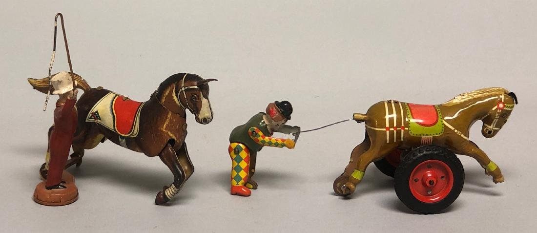 Two Tin Windup Horse Trainer Toys