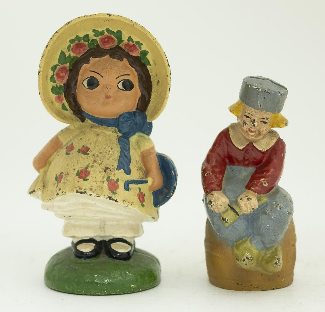 Two Figural Themed Cast Iron Still Banks