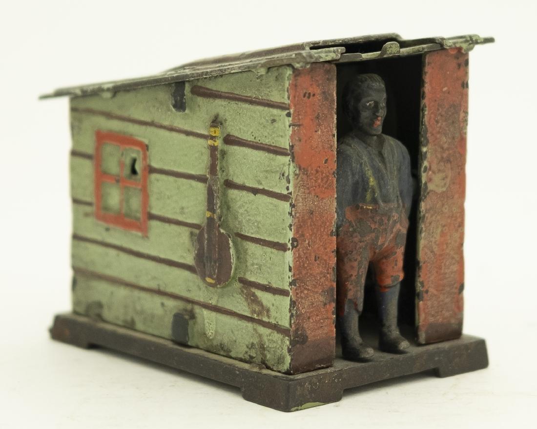 Green Cabin Cast Iron Mechanical Bank