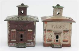 Two Medium Cupola Cast Iron Banks