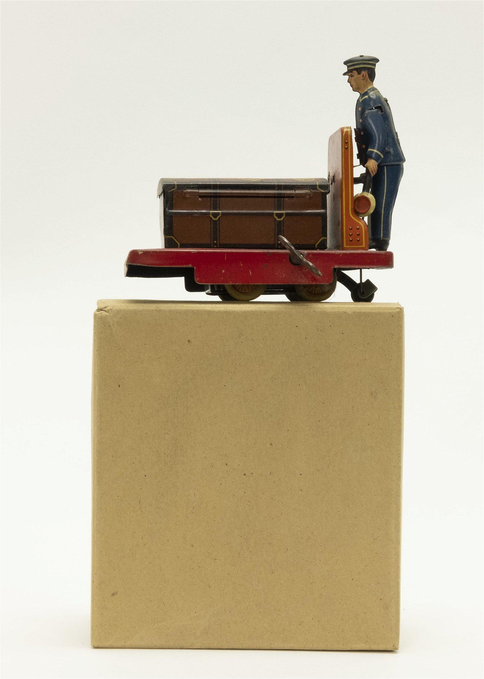 German Tin Windup Porter with Luggage Cart
