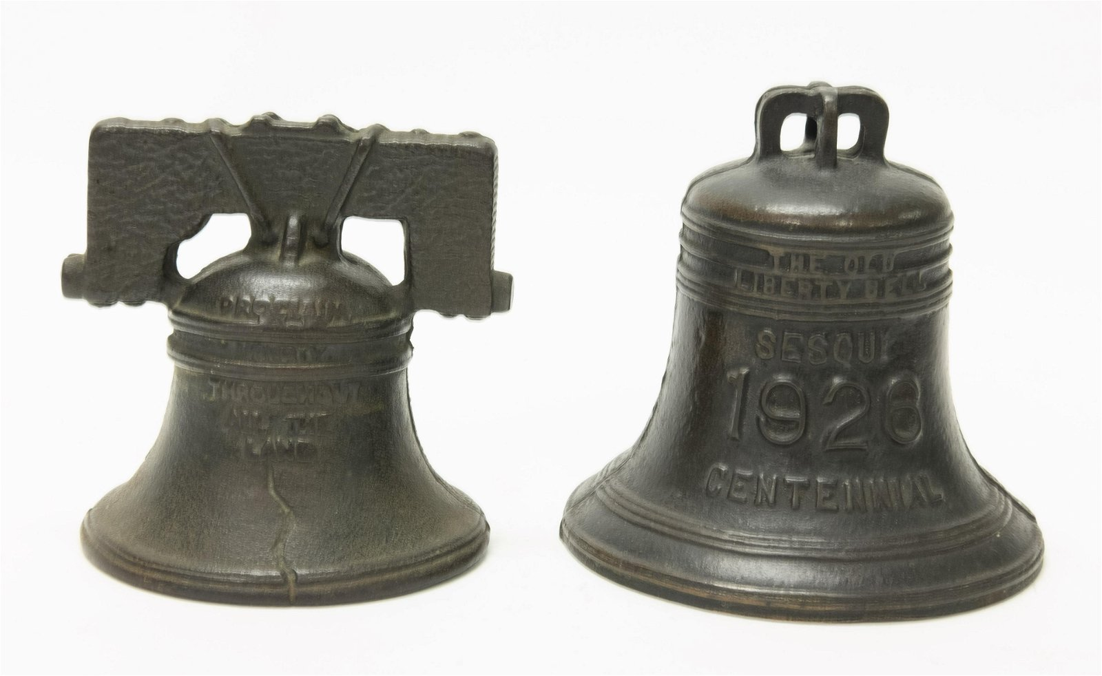 Two Liberty Bell Cast Iron Banks