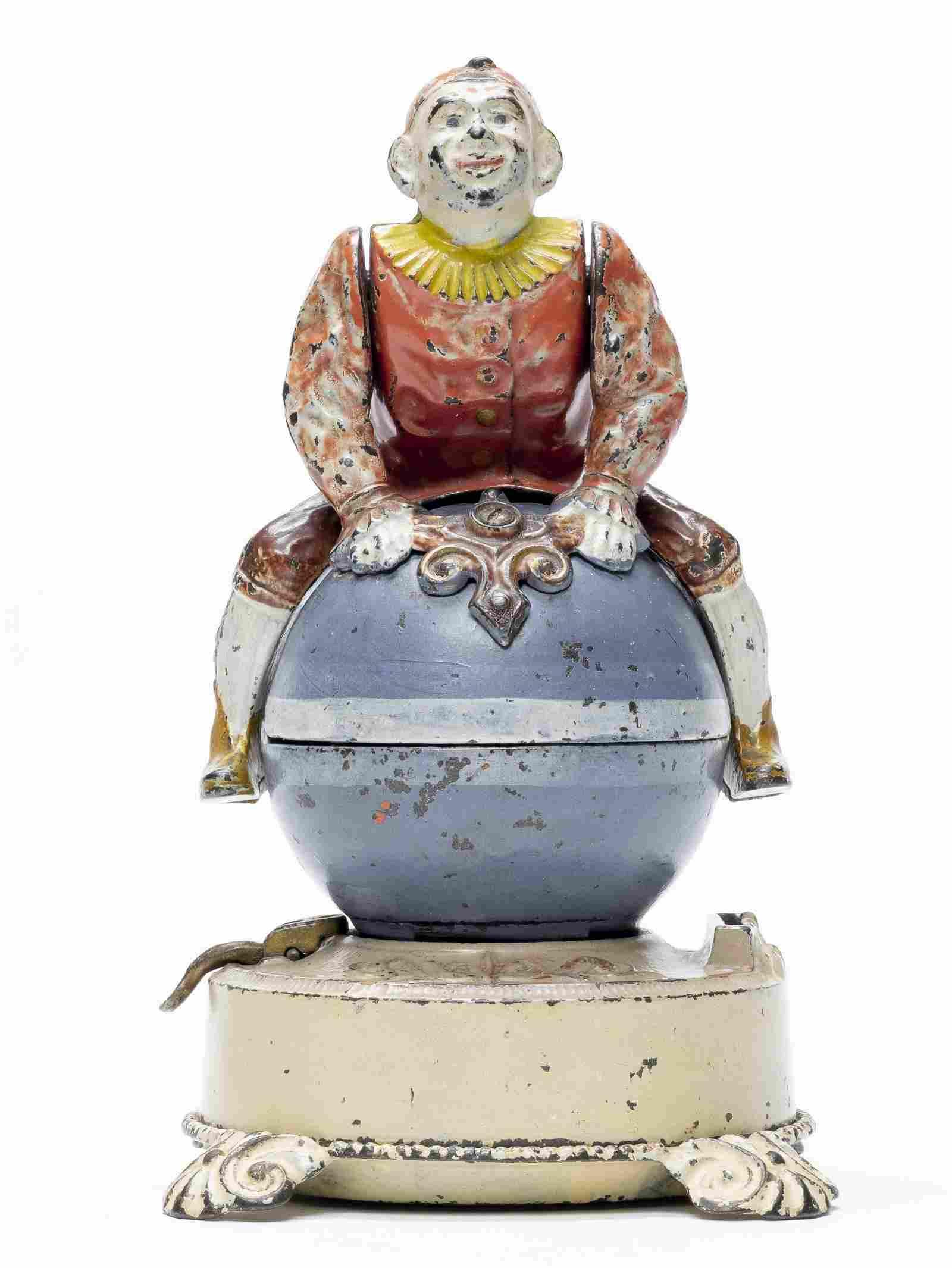 Clown on Globe Cast Iron Mechanical Bank