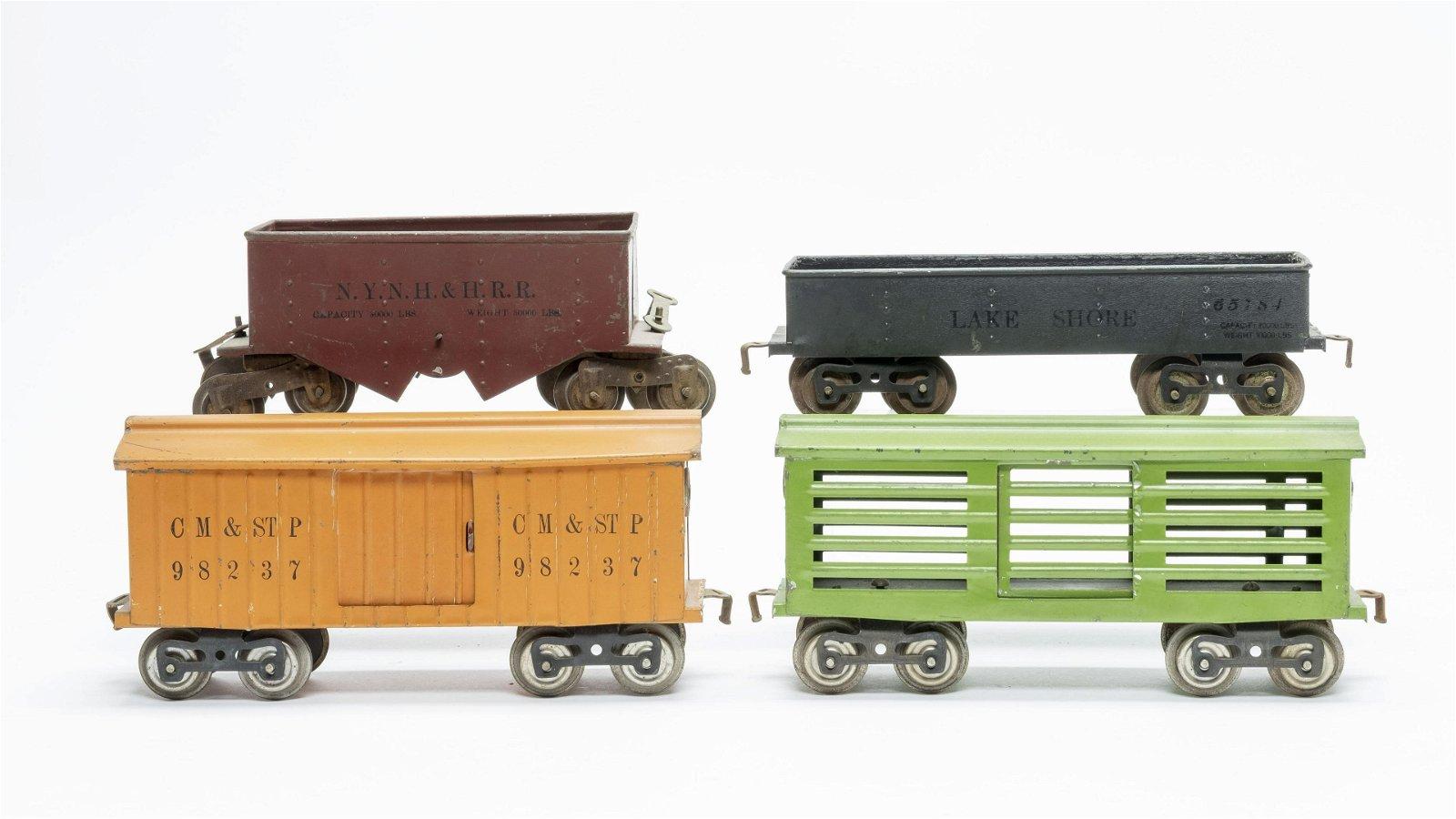 Four Lionel Train Cars