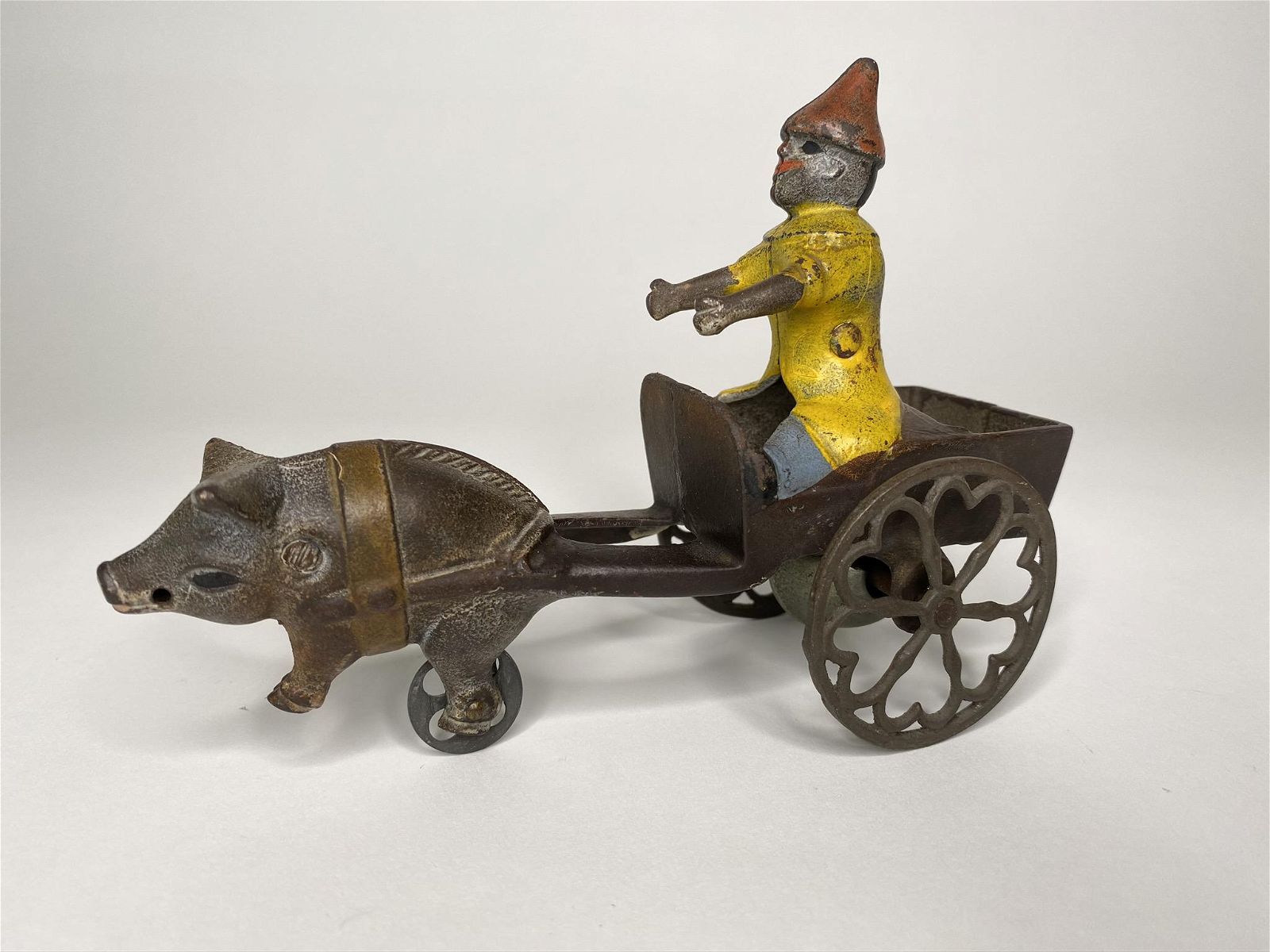 Pig Pulling Clown Cart Bell Toy