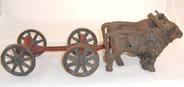 CAST IRON OXEN WITH CART