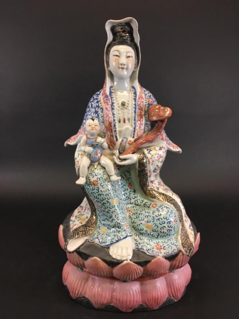 A FAMILLE ROSE FIGURE OF BUDDHA