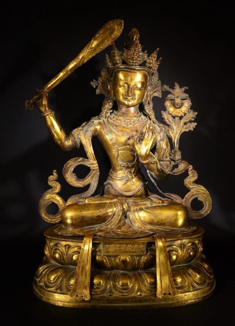 A GILT BROZNE FIGURE OF BUDDHA