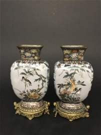 A PAIR OF BRONZE ENAMEL STANDS
