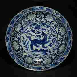 MING OR LATER, A BLUE AND WHITE DISH OF QILIN