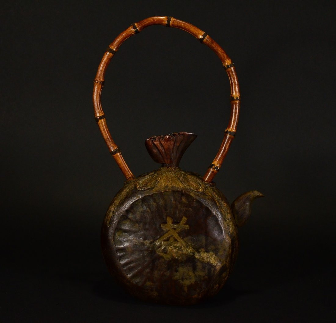 A BAMBOO CARVED TEAPOT