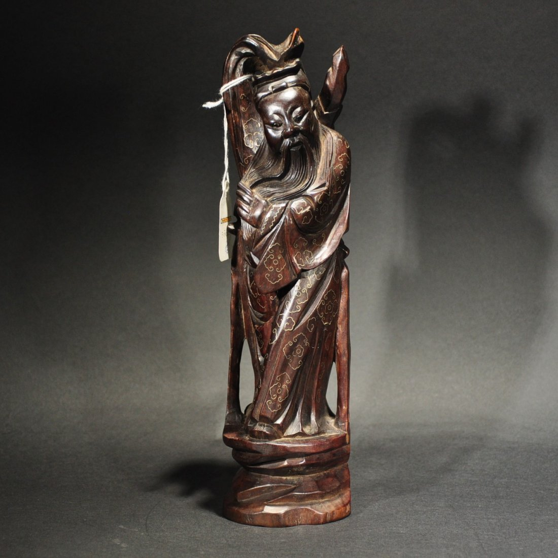A SILVER INLAID REDWOOD FIGURE