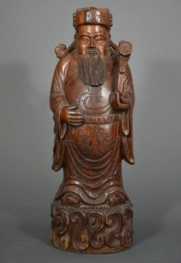 A CARVED WOOD FIGURE