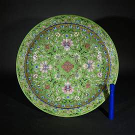 A GREEN GROUND FAMILLE ROSE FLORAL DISH