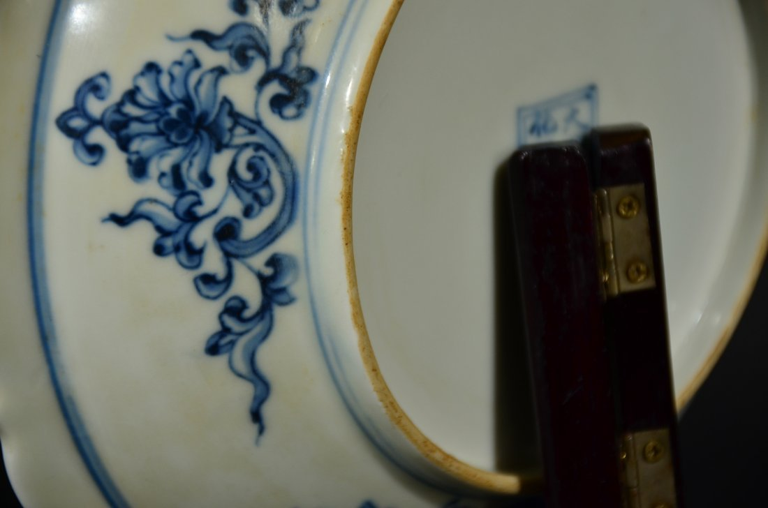A BLUE AND WHITE DISH - 7