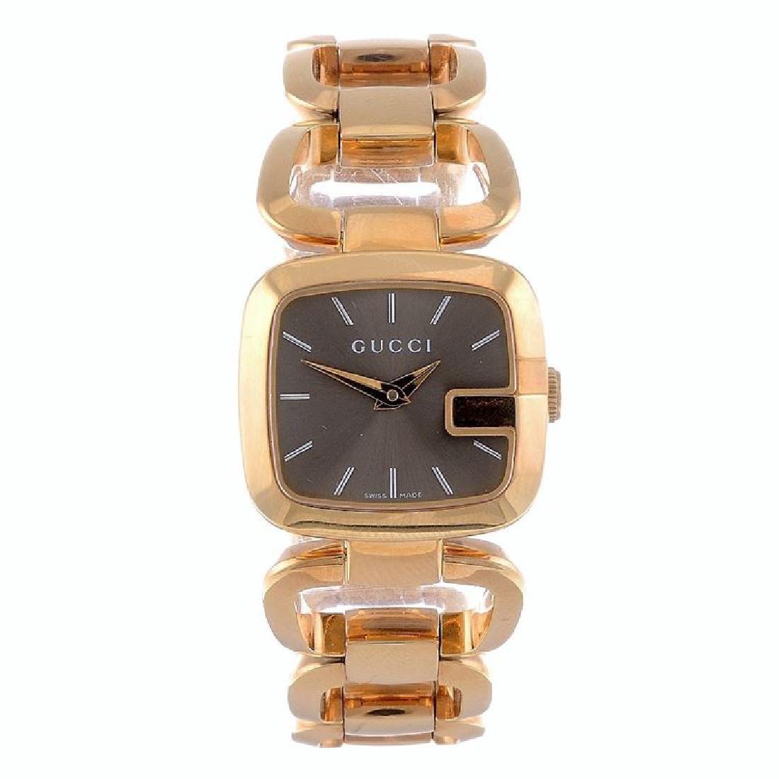 A lady's G-Gucci bracelet watch. Rose gold plated case.