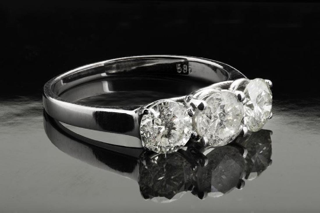 A new & certified 1.70 Ct 3 stone diamond ring set on
