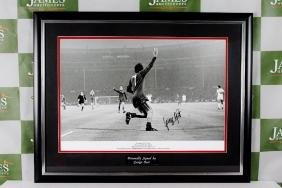 A large signed George Best photo celebrating the