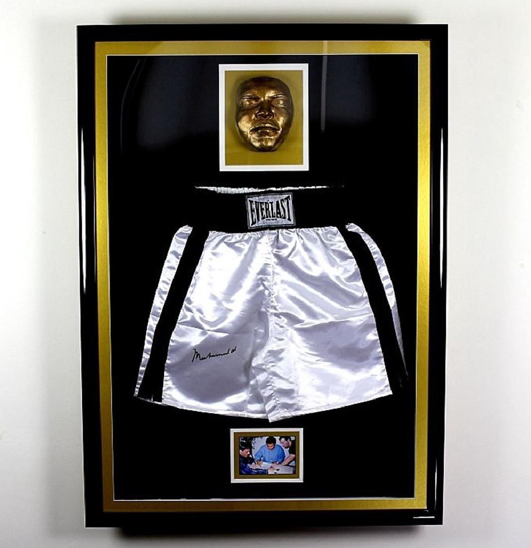 A huge Muhammed Ali signed Everlast shorts display ,