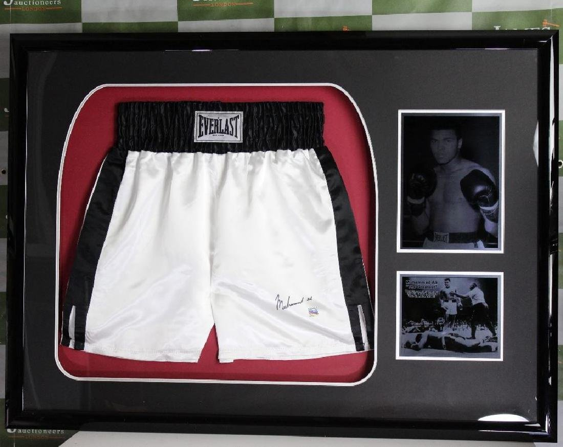 A stunning Muhammad Ali pair of signed Everlast shorts