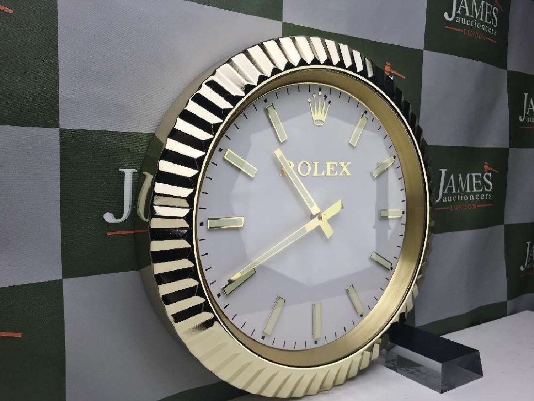 A Rolex wall clock