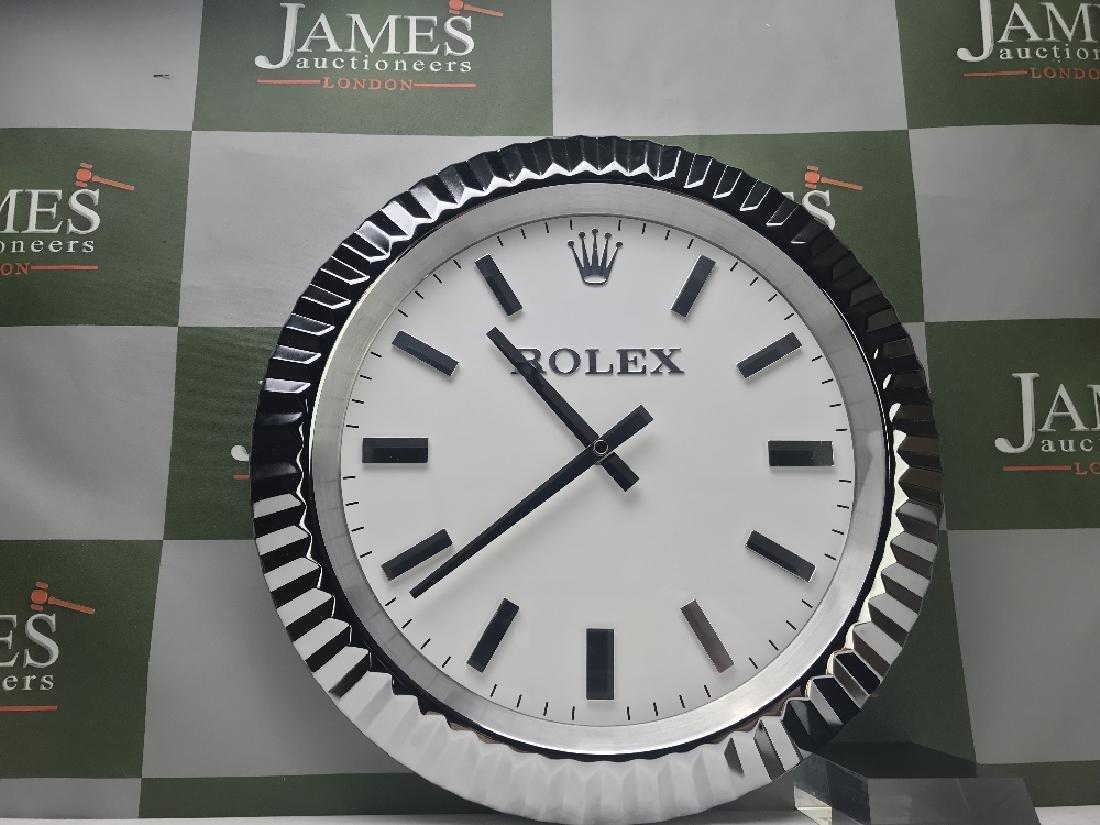 A Rolex wallclock