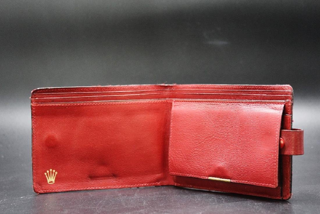 A Rolex vintage ox blood leather wallet