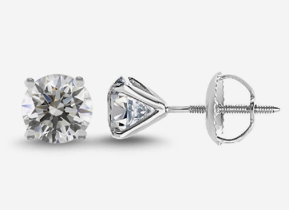 A pair of new genuine diamond 2ct earrings,certified &