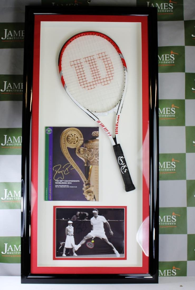 A signed Roger Federer racket & Wimbledon program
