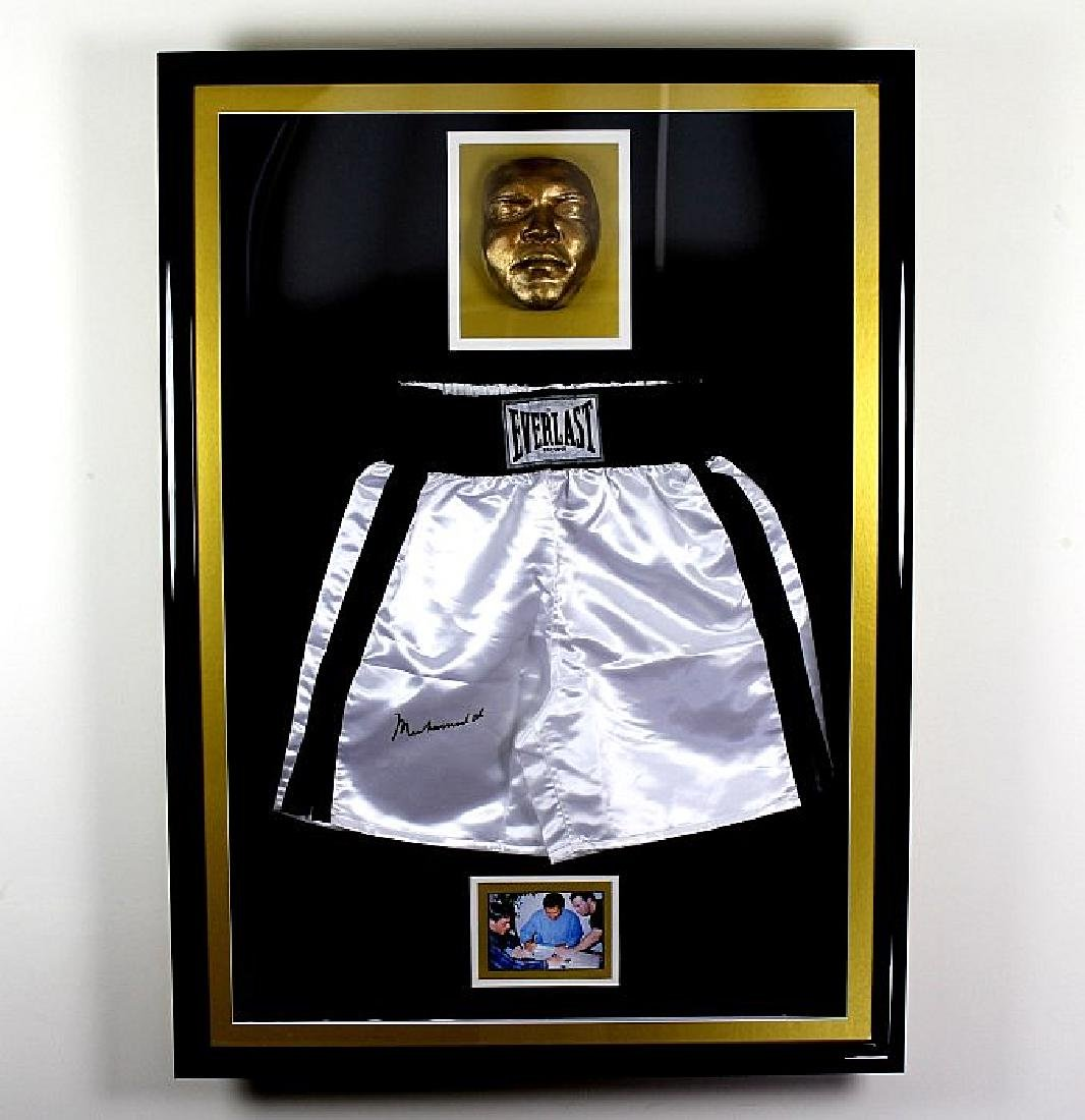 A huge Muhammed Ali signed Everlast shorts display ,
