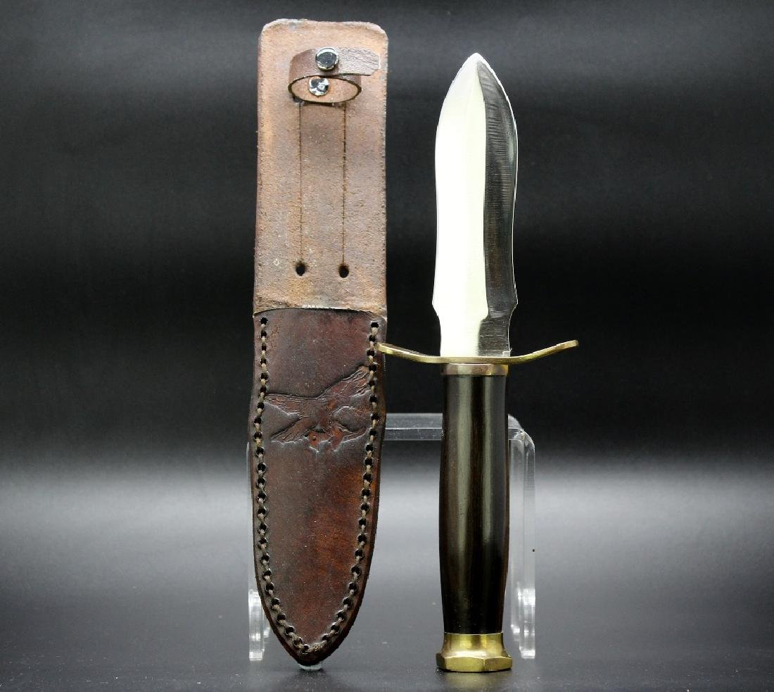 A archers daggers, 5ins bright steel blade, brass cross