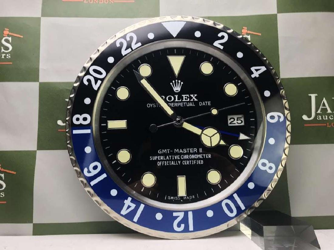 Rolex Dealer Oyster Perpetual Date GMT Submarine Clock